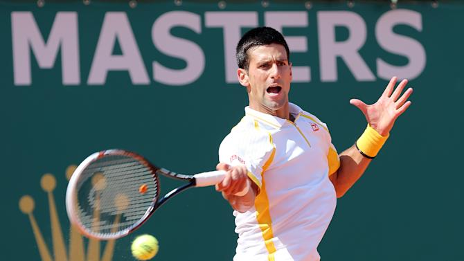 Novak Djokovic of Serbia plays a return to Spain's Rafael Nadal during their final match of the Monte Carlo Tennis Masters tournament in Monaco, Sunday, April 21, 2013. (AP Photo/Claude Paris)