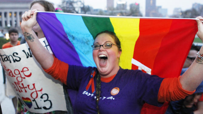 Rachel Ford cheers during a rally supporting a same-sex marriage bill in Minnesota on the steps of the State Capitol  in St. Paul, Minn., on Wednesday May 8, 2013. The Minnesota House is scheduled to debate and vote Thursday on a measure that would make the state the 12th in the country to allow gay marriage. (AP Photo/Andy Clayton King)
