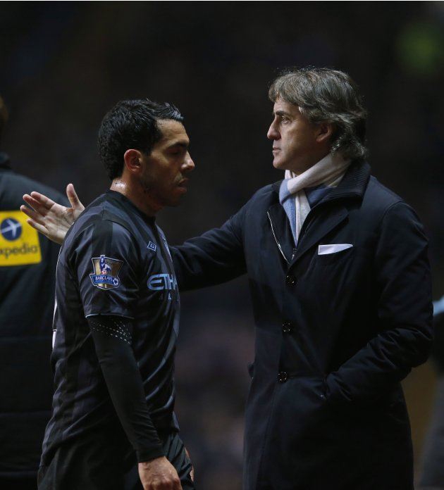 Manchester City manager Mancini congratulates player Tevez as he is substituted during their English Premier League soccer match against Aston Villa at Villa Park in Birmingham