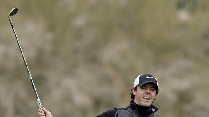 Northern Ireland's Rory McIlroy reacts after a shot on the 10th fairway in the first round against Shane Lowry, of Ireland, during the Match Play Championship golf tournament, Thursday, Feb. 21, 2013, in Marana, Ariz. (AP Photo/Ted S. Warren)