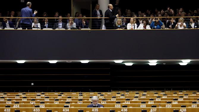 A member of the EU Parliament waits for the start of a plenary session of the EU Parliament in Brussels