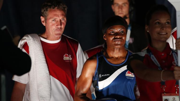 Adams of England walks into ring ahead of her women's flyweight fight against Oladeji of Nigeria at the 2014 Commonwealth Games in Glasgow