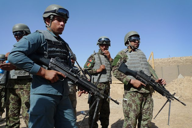 In this June 19, 2012 file photo, Afghan soldiers and a policeman prepare for a mock ambush as part of a training exercise at the U.S. Marine-run Joint Sustainment Academy, Camp Leatherneck in Helmand, south of Kabul. The U.S. suspects the Haqqani insurgent network, which has ties to al-Qaida and is based in Pakistan, is a driving force behind many of the insider attacks by Afghan forces that have killed more than 50 U.S. and allied troops this year, officials say. Until now, officials have said the attacks seemed to stem either from personal grievances against the allies or from Taliban infiltration. (AP Photo/Heidi Vogt)