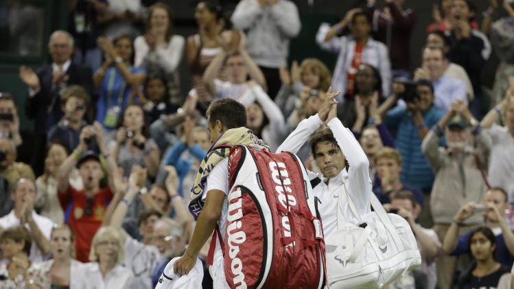 Rafael Nadal, right, of Spain acknowledges the crowd after being defeated by Lukas Rosol of the Czech Republic during a second round men's singles match at the All England Lawn Tennis Championships at Wimbledon, England, Thursday, June 28, 2012. (AP Photo/Anja Niedringhaus)