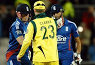 England's Eoin Morgan (L) and Ravi Bopara (R) shake hands with Australian captain Michael Clarke after winning the fifth one-day international at Old Trafford in Manchester, north-west England, late on July 10. Clarke admitted he hadn't seen a 4-0 one-day campaign defeat by England coming after his side made some unwanted history with Tuesday's defeat