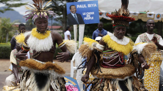 Supporters of Cameroon's incumbent President Paul Biya, dance during an election campaign meeting in Yaounde, Cameroon, Saturday, Oct. 8. 2011. Cameroonian's go to the polls Sunday in the final round of presidential elections. (AP Photo/Sunday Alamba)