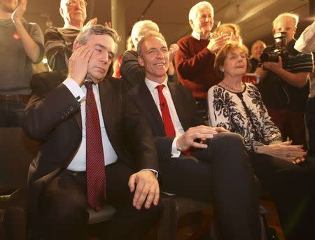 Former British Prime Minister Gordon Brown gestures after delivering his speech during a campaign event in Glasgow