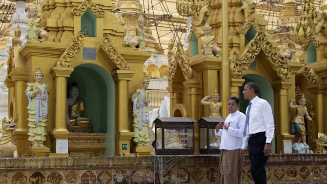 """FILE - This Nov. 19, 2012 file photo shows U.S. President Barack Obama touring the Shwedagon Pagoda in Yangon, Myanmar. Myanmar is on many lists as a hotspot for travel in 2013, including the U.S. Tour Operators Association, whose active members ranked the country No. 1 on a list of """"off the beaten path"""" destinations for the new year.  (AP Photo/Carolyn Kaster, file)"""