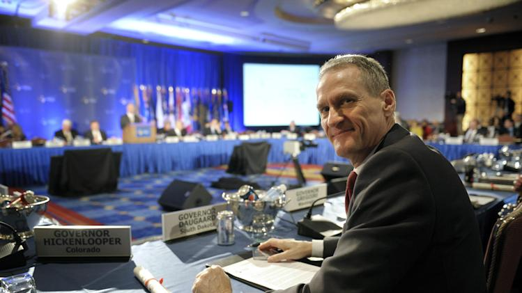 South Dakota Gov. Dennis Daugaard waits for the start of the opening session of the National Governors Association winter meeting in Washington, Saturday, Feb. 25, 2012. (AP Photo/Cliff Owen)