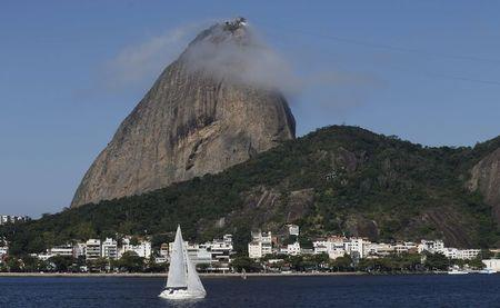 A boat is pictured with the Sugarloaf Mountain in the background, at the Guanabara Bay in Rio de Janeiro