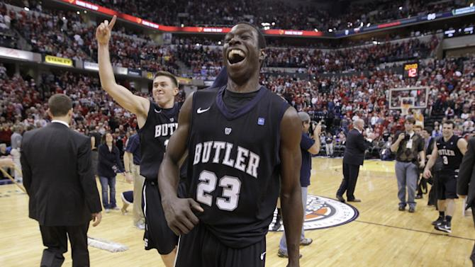 Butler forward Khyle Marshall (23) and guard Rotnei Clarke celebrate after Butler defeated No. 1 Indiana 88-86 in overtime in an NCAA college basketball game in Indianapolis, Saturday, Dec. 15, 2012. (AP Photo/Michael Conroy)