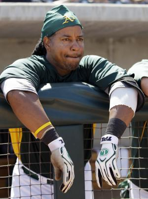 In this March 10, 2012, photo, Oakland Athletics' Manny Ramirez looks on from the dugout during a spring training baseball game against the Cincinnati Reds in Phoenix. Suspended slugger Ramirez is scheduled to begin a 10-game minor league stint with Triple-A Sacramento on Saturday, May 19, in Albuquerque, N.M. Barring rainouts, the designated hitter and outfielder is eligible to be activated by the Athletics from his 50-game suspension on May 30--his 40th birthday--for the finale of a weekend series at Minnesota. (AP Photo/Marcio Jose Sanchez)