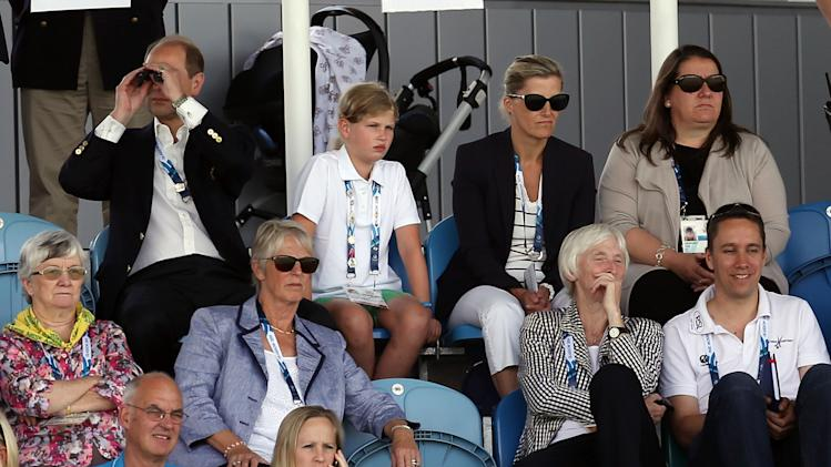 Britain's Prince Edward, top row left, looks on with his wife Sophie, Duchess of Wessex, top row 2nd right, and daughter Louise, top row 2nd left, at the women's field hockey match between Australia and England during the Commonwealth Games Glasgow 2014, at the National Hockey Centre, Glasgow Scotland, Monday July 28, 2014. (AP Photo/ Scott Heppell)