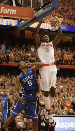 Syracuse's Jerami Grant, right, jams the ball for two points against Duke's Rodney Hood, left, in overtime of an NCAA college basketball game in Syracuse, N.Y., Saturday, Feb. 1, 2014. Syracuse won 91-89. (AP Photo/Nick Lisi)