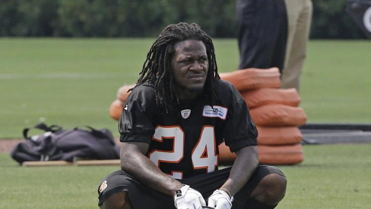 """In this June 12, 2013, file photo, Cincinnati Bengals cornerback Adam """"Pacman"""" Jones rests during the NFL football team's mandatory minicamp in Cincinnati.  A court official said Jones has paid a fine for disorderly conduct after police accused him of making offensive comments in a traffic stop. The official says Jones paid $130 for the fine and court costs on Thursday, Sept. 27, 2013  the day before a scheduled arraignment in Cincinnati"""