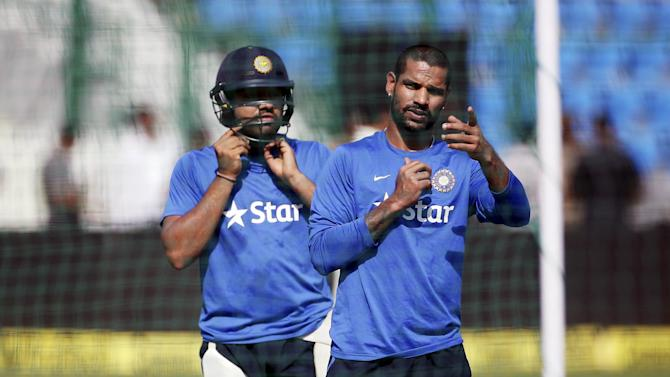 India's Dhawan and Sharma prepare to bat during a practice session ahead of their first one-day international cricket match against South Africa in Kanpur