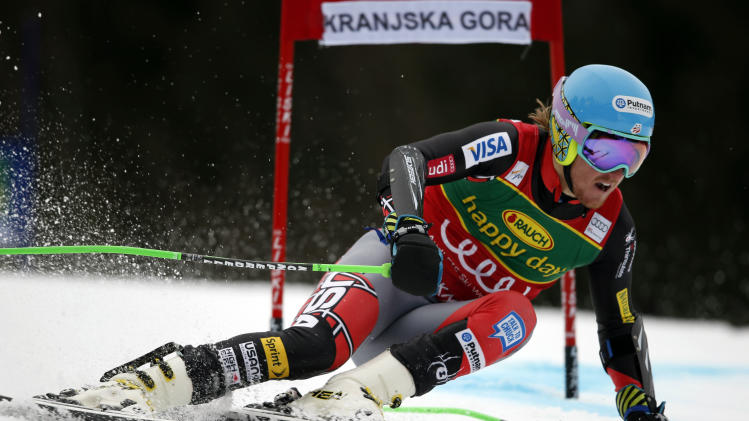 Ted Ligety, of the United States, passes a gate during the first run of an alpine ski, men's World Cup giant slalom, in Kranjska Gora, Slovenia, Saturday, March 9, 2013. (AP Photo/Shinichiro Tanaka)