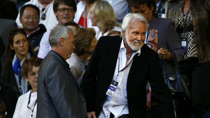 U.S. singer Rogers attends the men's singles semi-final match between Murray of Britain and Berdych of Czech Republic at the Australian Open 2015 tennis tournament in Melbourne