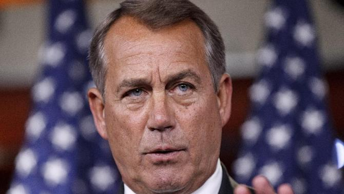 FILE - In this March 1, 2012 file photo, House Speaker John Boehner of Ohio gestures during a news conference on Capitol Hill in Washington. House Republicans follow up their frugal _ but nonbinding _ tea party budget with less stringent cuts. Instead of promised slashes to Medicaid and food stamps, top GOP lawmakers are thinking smaller. And they're even reaching out to Democrats to help pass annual spending bills.  (AP Photo/J. Scott Applewhite, File)