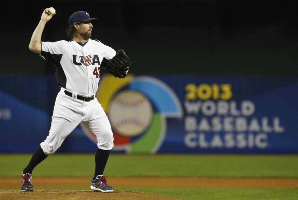 United States' R.A. Dickey attempts a pick off throw in the first inning during a World Baseball Classic baseball game between Mexico and the United States on Friday, March 8, 2013, in Phoenix. (AP Photo/Ross D. Franklin)