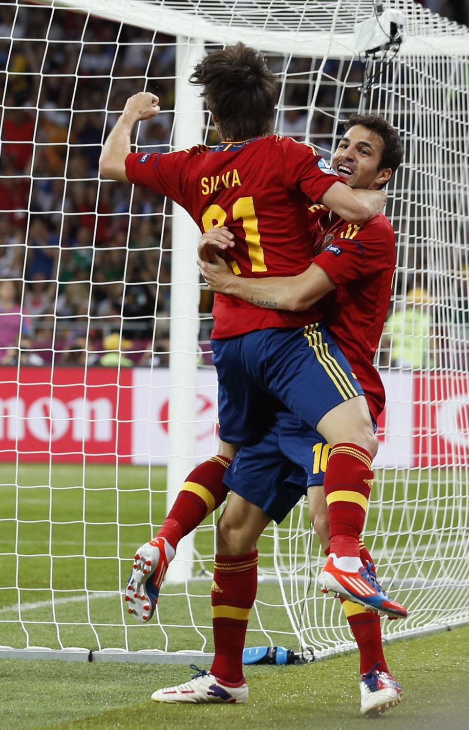Spain's David Silva, left,  celebrates with teammate Cesc Fabregas after scoring during the Euro 2012 soccer championship final  between Spain and Italy in Kiev, Ukraine, Sunday, July 1, 2012. (AP Photo/Jon Super)