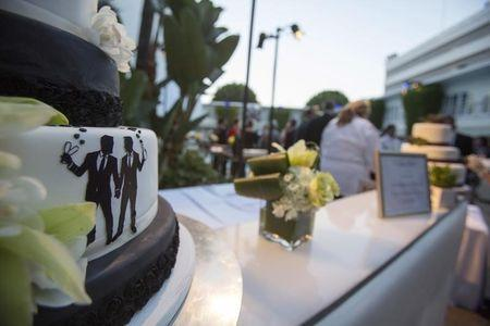 Groom figurines are seen on a cake at a ceremony to celebrate the wedding of Jeff Zarrillo and Paul Katami at Beverly Hilton Hotel in Beverly Hills