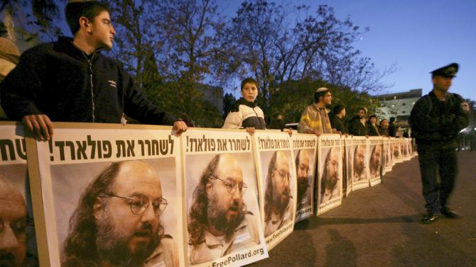 Israeli protesters hold posters calling for the release of Pollard in Jerusalem