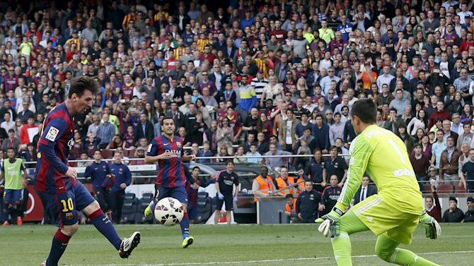 Barcelona's Lionel Messi shoots to score a goal against Valencia's goalkeeper Diego Alves  during their Spanish first division soccer match at Camp Nou stadium in Barcelona