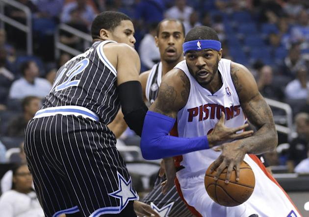 Detroit Pistons' Josh Smith, right, drives to the basket past Orlando Magic's Tobias Harris during the first half of an NBA basketball game in Orlando, Fla., Wednesday, Feb. 5, 2014. (AP Photo
