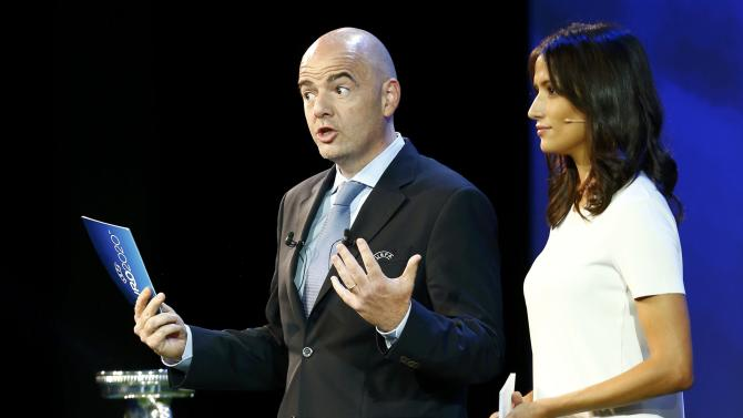 Former Miss Switzerland Winiger and UEFA General Secretary Infantino open the UEFA EURO 2020 host cities announcement ceremony in Geneva