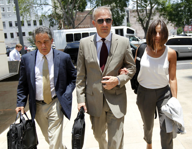 Kevin Costner, center, arrives at Federal Court on Thursday, June 14, 2012 in New Orleans.  A jury is set to hear closing arguments in the trial for Stephen Baldwin's lawsuit against Costner over thei