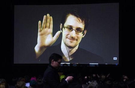 Former U.S. National Security Agency contractor Edward Snowden appears live via video during a student organized world affairs conference at the Upper Canada College private high school in Toronto