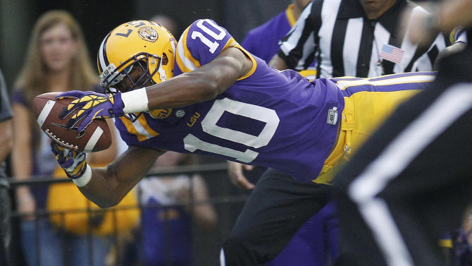 LSU wide receiver Russell Shepard dives into the end zone, scoring on a 78-yard touchdown run in the first half of an NCAA college football game against Towson in Baton Rouge, La., Saturday, Sept. 29, 2012. (AP Photo/Bill Haber)