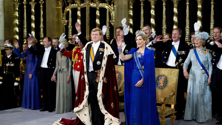 Dutch King Willem-Alexander is given three cheers by guests and his wife Queen Maxima inside the Nieuwe Kerk or New Church in Amsterdam, The Netherlands, during his inauguration Tuesday April 30, 2013. Around a million people are expected to descend on the Dutch capital for a huge street party to celebrate the first new Dutch monarch in 33 years.  (AP Photo/Robin Utrecht, Pool)