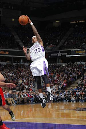 Cousins, Gay lead Kings by Raptors 109-101