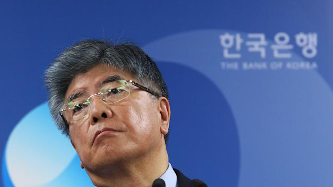 Kim Choong-soo, governor of the Bank of Korea, listens to a reporter's question during a press conference on the benchmark interest rate at the bank's headquarters in Seoul, South Korea, Thursday, Oct. 11, 2012. South Korea's central bank cut its key interest rate Thursday for the second time this year and slashed growth forecasts as Asia's fourth-largest economy faces mounting threats from the protracted debt crisis in Europe and a worsening global slowdown.(AP Photo/Ahn Young-joon)