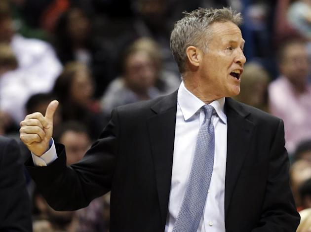 Philadelphia 76ers head coach Brett Brown gestures during the first half of an NBA basketball game against the Milwaukee Bucks, Saturday, Dec. 21, 2013, in Milwaukee