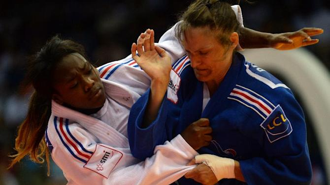 France's judoka Anne-Laure Bellard (blue) competes with France's Clarisse Agbegnenou during the under 63 kg category semi-final at the IJF World Judo Championship in Chelyabinsk on August 28, 2013