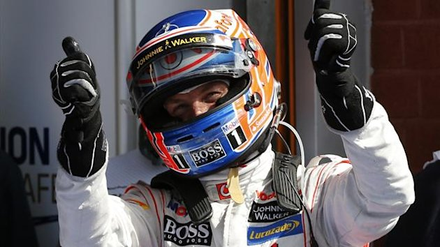 McLaren Formula One driver Jenson Button of Britain celebrates his pole position after the qualifying session of the Belgian F1 Grand Prix (Reuters)