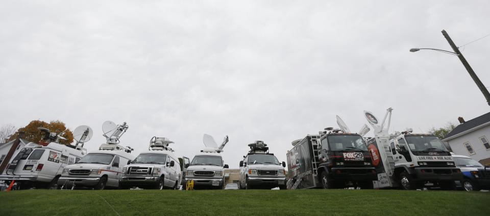 News trucks fill a parking lot near the Centre County Courthouse Monday, Oct. 8, 2012, in Bellefonte, Pa. Former Penn State University assistant football coach Jerry Sandusky is scheduled to be sentenced Tuesday for sexually abusing 10 boys in a scandal that rocked the university and brought down coach Joe Paterno. (AP Photo/Matt Rourke)