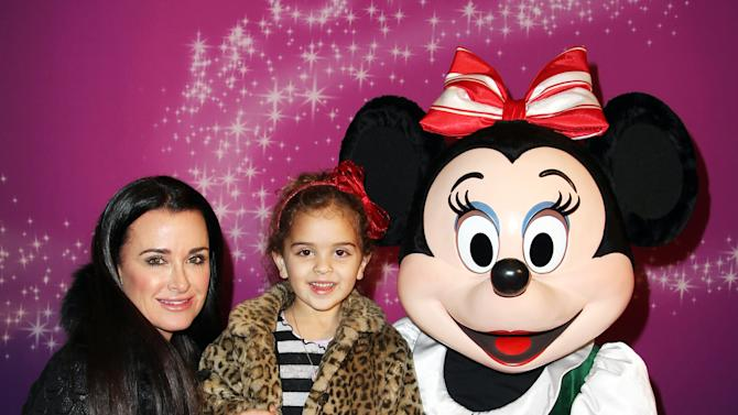 Kyle Richards, left, and her daughter, Portia Umansky, pose with Minnie Mouse at AEG's Season of Giving celebrates Disney on Ice: Dare to Dream and Baby Buggy's Holiday Diaper Drive at L.A. LIVE on Wednesday, Dec. 12, 2012, in Los Angeles. (Photo by Matt Sayles/Invision for AEG/AP Images)