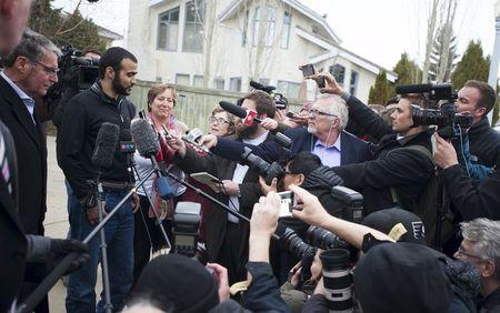 Lawyer Edney and Khadr answer questions during a news conference after Khadr was released on bail in Edmonton.