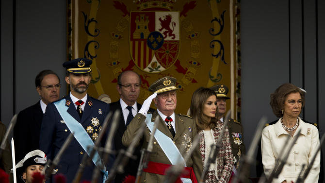Spain's Crown Prince Felipe, left, Spain's King Juan Carlos, center left, Princess Letizia and Queen Sofia, right, attend a military parade, during the holiday known as Dia de la Hispanidad, Spain's National Day, in Madrid, Friday, Oct. 12, 2012. King Juan Carlos presided over a much reduced parade that featured none of the usual fighter jets or tanks as they celebrate the day Christopher Columbus discovered America in the name of the Spanish Crown.(AP Photo/Daniel Ochoa de Olza)