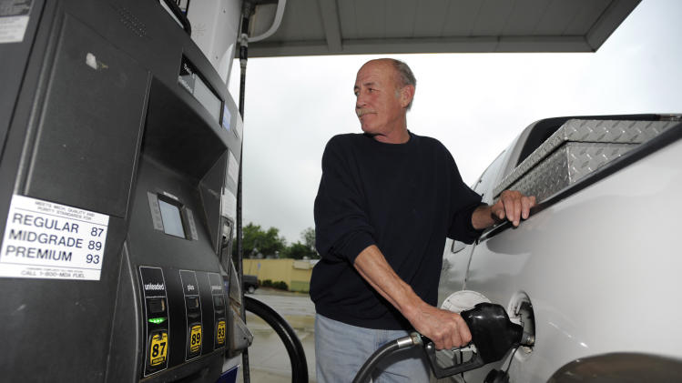 Mike Dawkins, of Royal Oak, pumps gas at a Marathon station in Royal Oak, Monday, June 10, 2013. Michigan and other Upper Midwest states are seeing the highest gasoline prices in the continental U.S. But analysts say the worst is over and prices should begin to drop soon. (AP Photo/The Detroit News, David Guralnick)