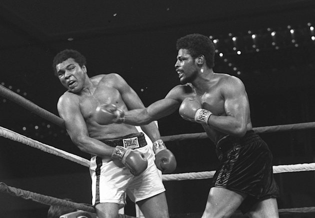 "FILE - Leon Spinks connects with a right hook to Muhammad Ali, in this Feb.16, 1978 file photo taken during the late rounds of their championship fight in Las Vegas, Nev. The 24-year-old Spinks won the bout in a 15-round decision. Muhammad Ali lost just twice in his seven prizefights in Las Vegas over 19 years. Now, dozens of heavyweight celebrities are back in Sin City to laud a lifetime in the spotlight and join the icon known as ""The Greatest"" in fighting neurological diseases. (AP Photo, File)"