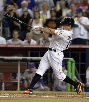 Miami Marlins' Adam Greensberg swings at the third strike against the New York Mets during the sixth inning of a baseball game in Miami, Tuesday, Oct. 2, 2012. (AP Photo/Alan Diaz)