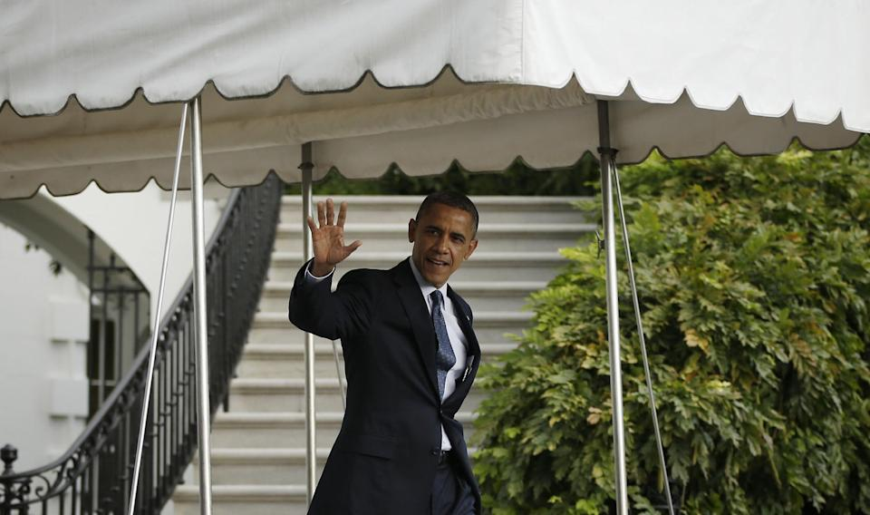 President Barack Obama waves as he walks out of the White House in Washington, Friday, Oct., 19, 2012, before his departure on Marine One helicopter for a trip to the presidential retreat at Camp David, Md., to spend the weekend preparing for his final presidential debate.(AP Photo/Pablo Martinez Monsivais)