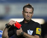 Referee Mark Clattenburg puts his red card away after sending off Chelsea&#39;s Serbian defender Branislav Ivanovic during match between Chelsea and Manchester United at Stamford Bridge in London. Chelsea have accused Clattenburg of speaking out of turn to two of their players
