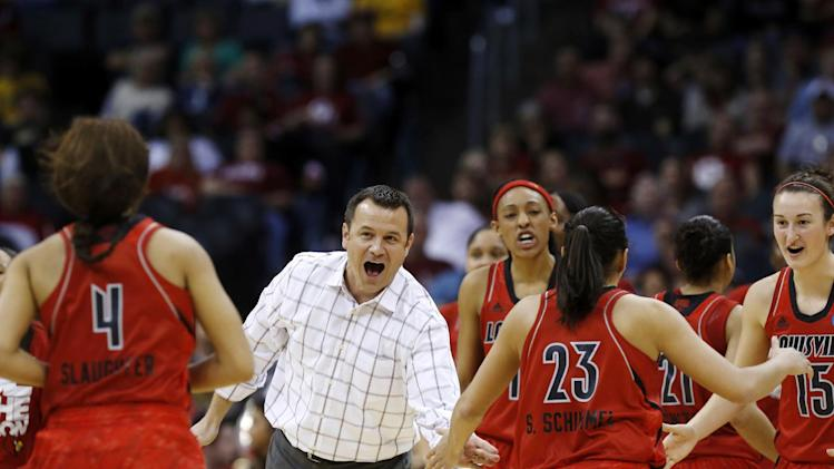 Louisville head coach Jeff Walz greets his players as they run back to the bench during a timeout in the second half of a regional semifinal game against Baylor in the women's NCAA college basketball tournament in Oklahoma City, Sunday, March 31, 2013. Louisville won 82-81. (AP Photo/Sue Ogrocki)