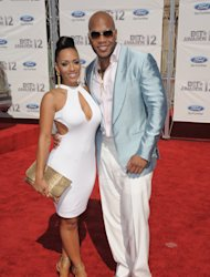 Melyssa Ford, left, and Flo Rida arrive at the BET Awards on Sunday, July 1, 2012, in Los Angeles. (Photo by Jordan Strauss/Invision/AP)